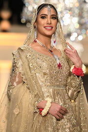 Pakistani Peplum Lehnga in Gold Color for Wedding Close Up