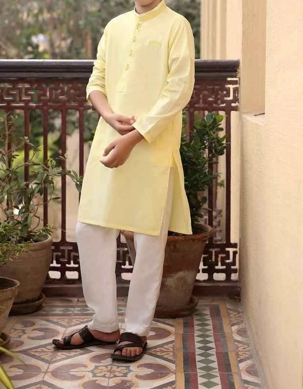Pakistani designer boys kurta in lemon yellow color