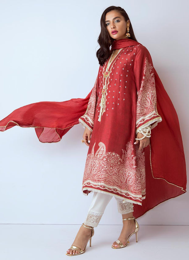 Beautiful Pakistani designer silk dress in red color
