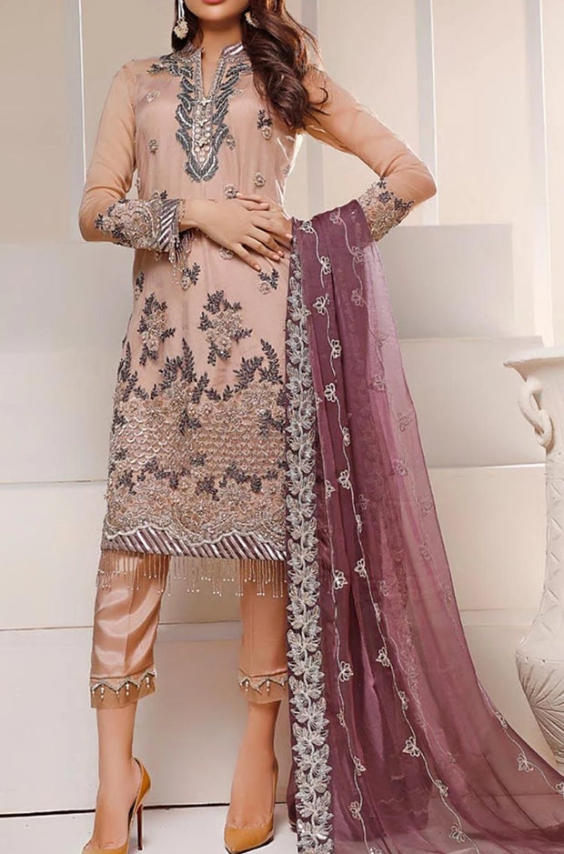 Pakistani designer wear in lavish embroidered work and colors