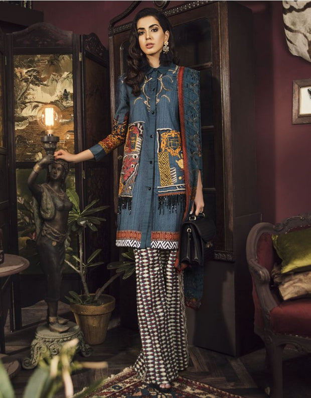Beautiful embroidered Pakistani linen dress in blue color