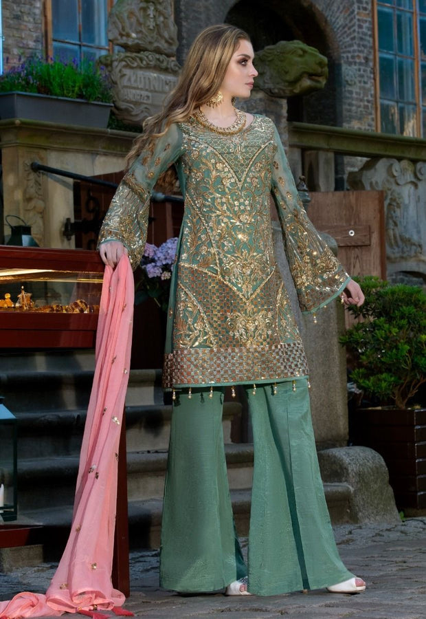 Beautiful Pakistani sequins embroidered dress in green color
