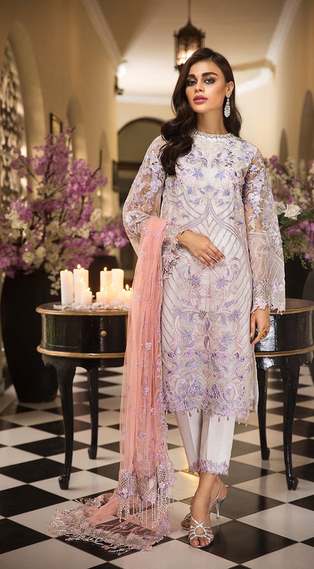 Pakistani thread embroidered dress in an elegant light color