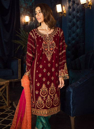 Beautiful Pakistani velvet embroidered party dress in maroon color
