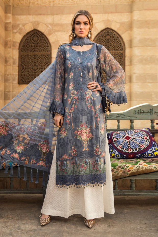 Embroidered Pakistani designer eid dress in lavish blue color