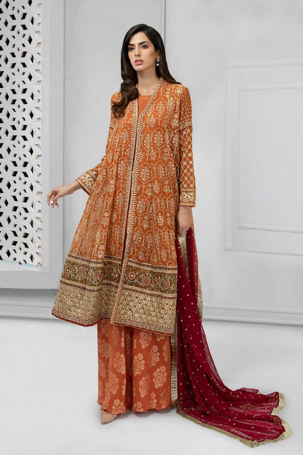 Latest Pakistani fancy outfit for party in shining rust color