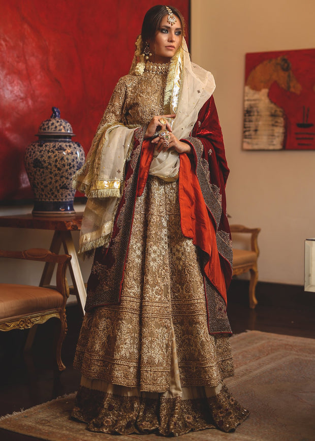 Red anarkali frock by Pakistani designer beautifully embroidered