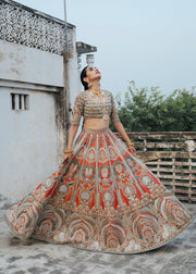 Latest silk embroidered lehnga in orange color for wedding wear # B3409