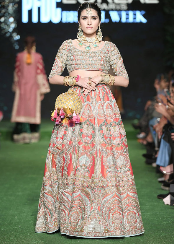 Latest silk embroidered lehnga in orange color for wedding wear