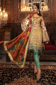 Traditional Pakistani wedding dress in shimmering gold color