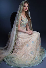 Elegant white peach lehnga with mukaish and gotta work
