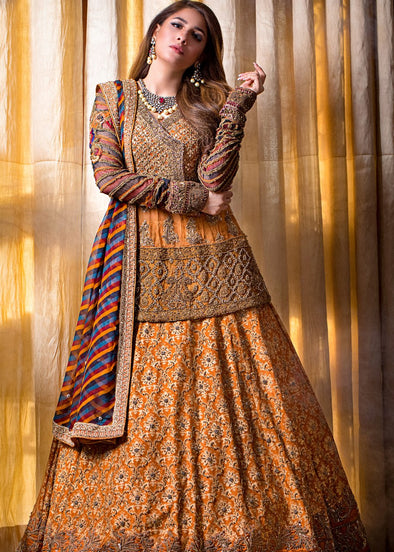 Beautiful designer yellow mehndi lehnga dress with multi work