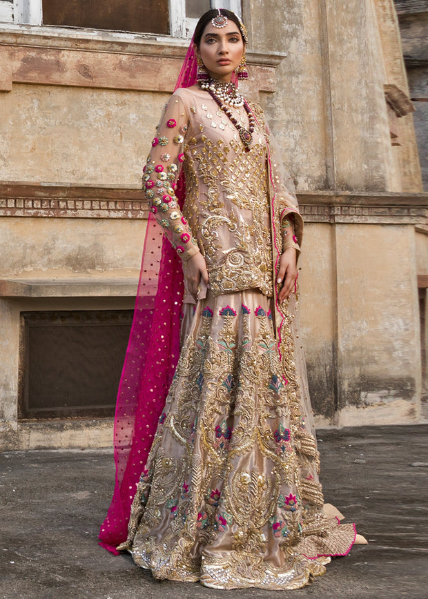 Latest bridal lehnga dress for wedding wear in pink gold color