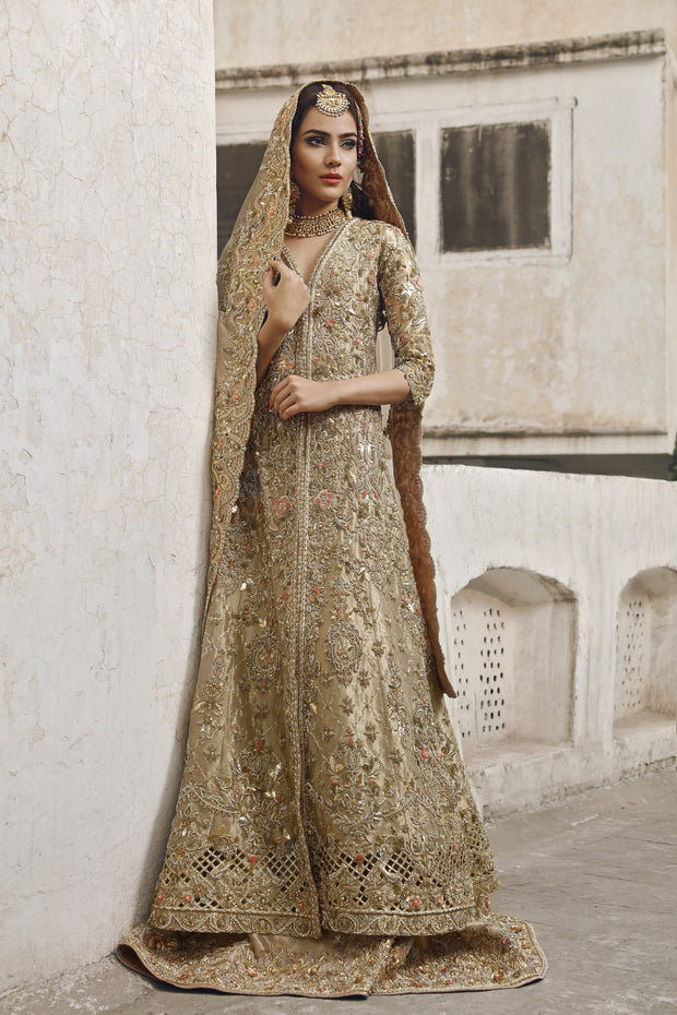 Latest Pakistani designer bridal peshwaz dress in dull gold color