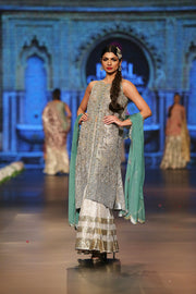 Designer embroidered dress in gold, white and green color