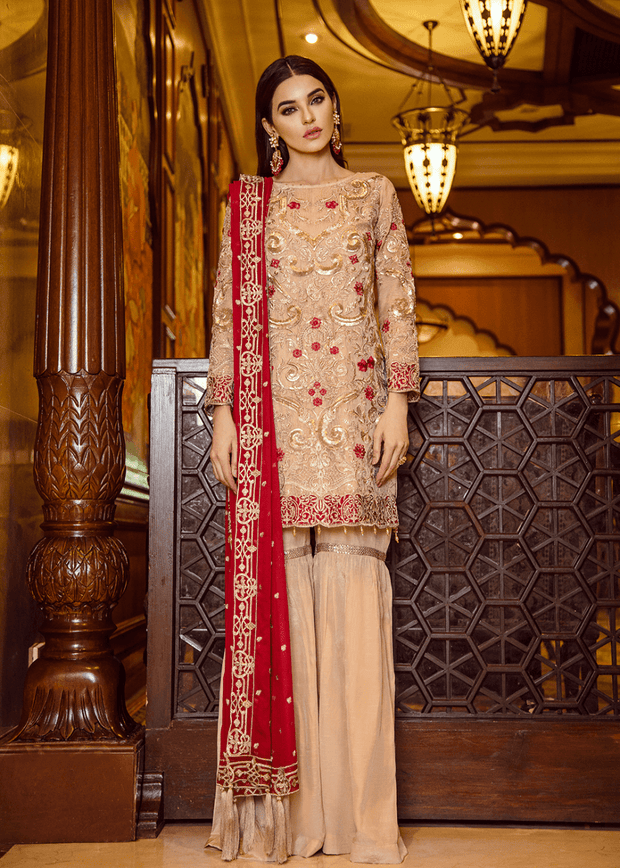 Pakistani designer embroidered outfit in skin color