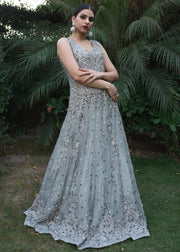 Beautiful gown dress embroidered with pearls in grey color