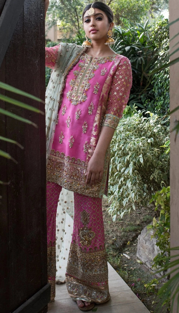 Alluring Pakistani designer party dress in lavish pink color