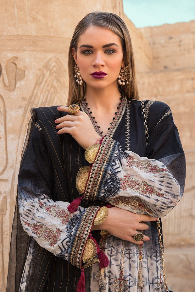 Pakistani embroidered designer eid dress in black and skin color