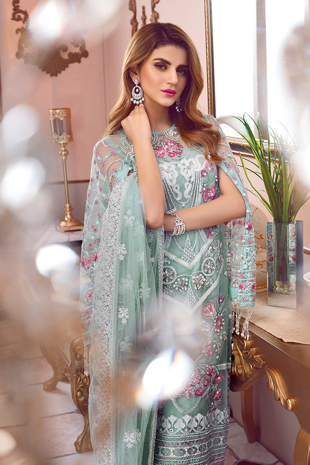 Pakistani designer embroidered net outfit in green color # P2338
