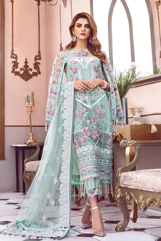 Pakistani designer embroidered net outfit in green color
