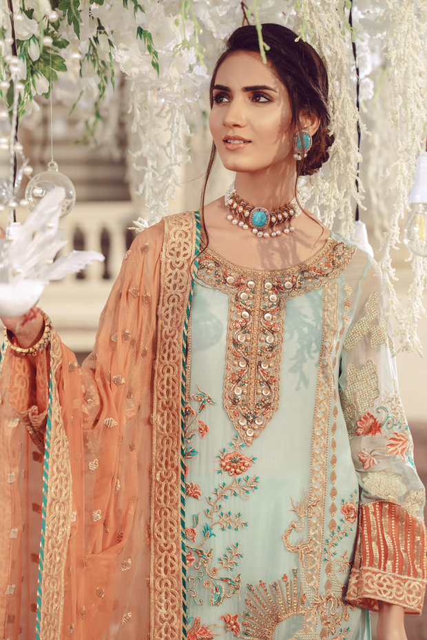Pakistani embroidered formal eid outfit in green and peach color