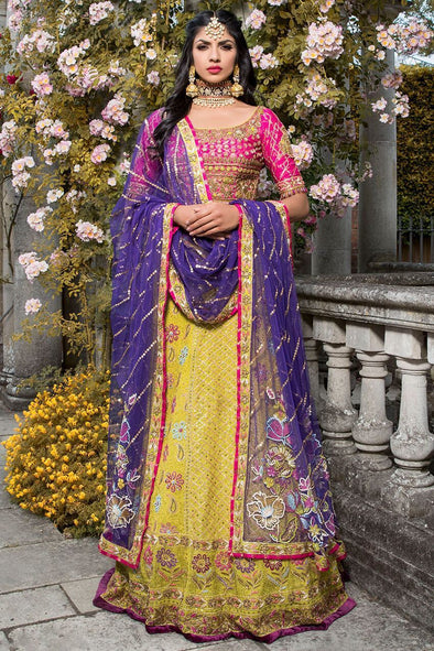 Elegant Indian mehndi dress in yellow and pink color