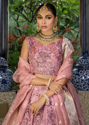 Latest Pakistani designer tea pink color lehnga dress for wedding