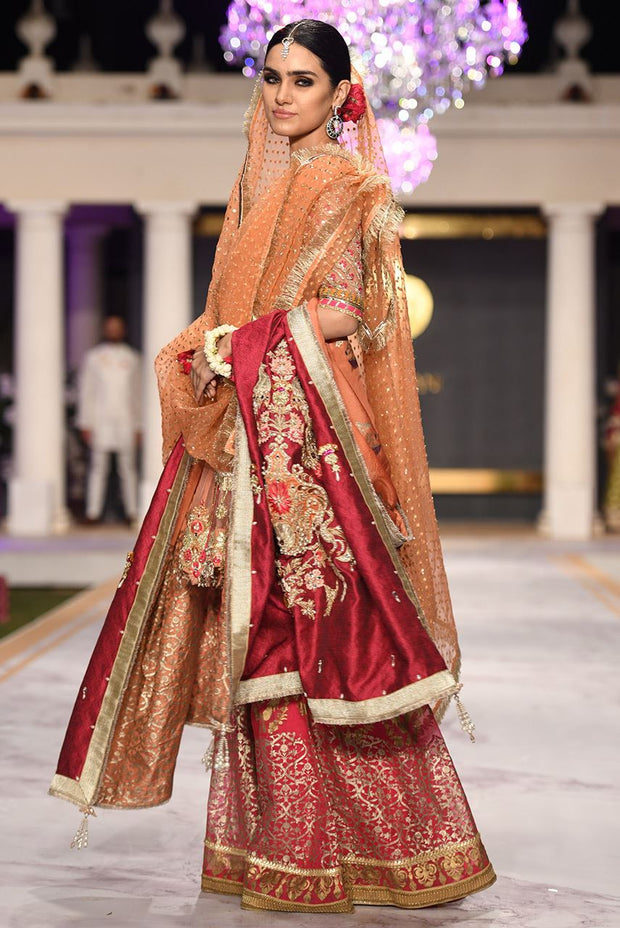 Beautiful designer bridal mehendi outfit embroidered in red color