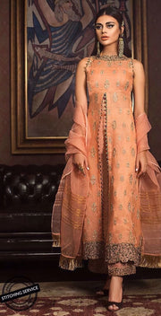 Elegant designer organza dress in peach color