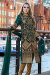Pakistani designer zardozi embroidered dress in green color