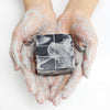 Dear, Klairs Gentle Black Sugar Charcoal Soap product in hands