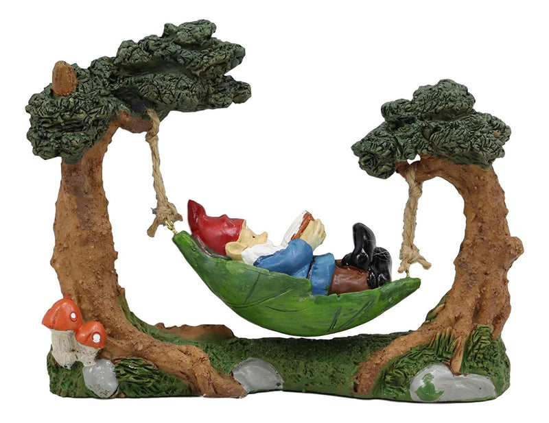 "Ebros Whimsical Bookworm Gnome Sleeping On Hammock by Toadstool Mushrooms Forest Tree Ents Statue 6.5"" Wide"