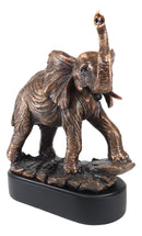 Large African Long Tusked Elephant Marching With Trunk Raised Statue With Base