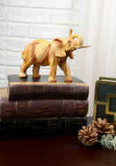 Safari Savannah Landscape Majestic Elephant With Trunk Up Faux Wood Figurine