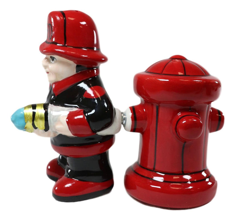 Fireman Fighter With Hose By Red Fire Hydrant Ceramic Salt And Pepper Shakers