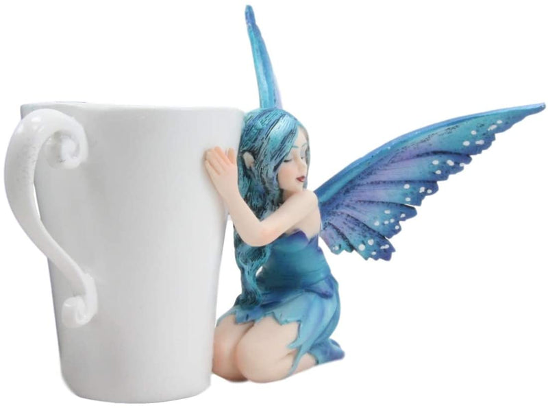 "Ebros Amy Brown Warmth Comfort Blue Fairy Hugging Tea Cup Statue 4.25""H Fantasy"