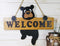 Black Bear Cub Hanging On Welcome Sign Plank MDF Wood Door Or Wall Decorative