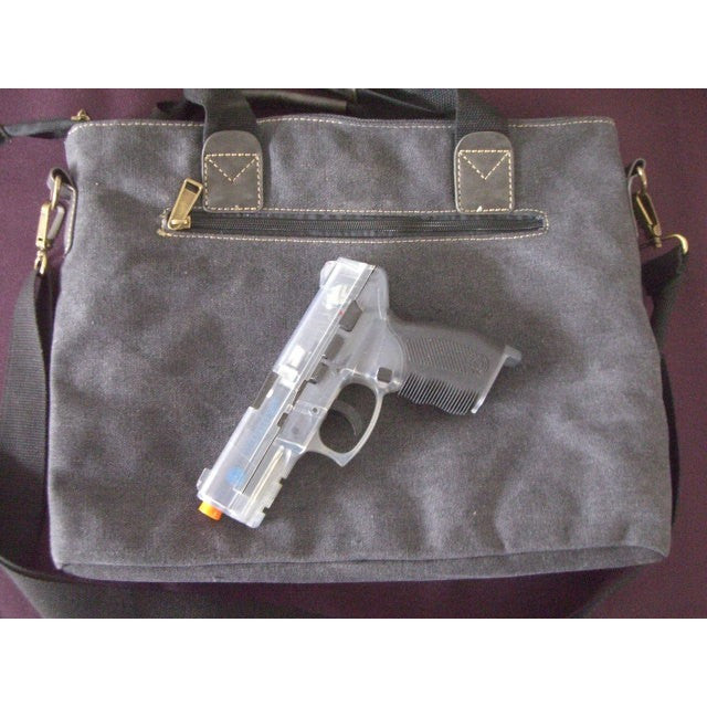 Camille Conceals Canvas Concealed Carry Briefcase Holster Position