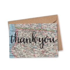 thank you in script font printed on recycled vintage map