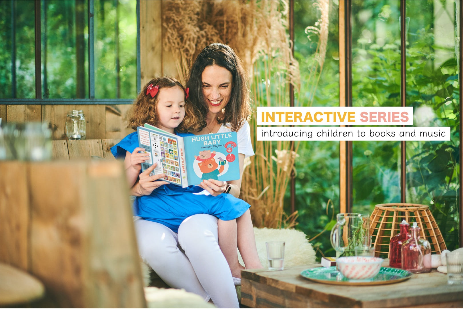 Cali's Books Interactive Musical Books. Mom and Daughter reading together