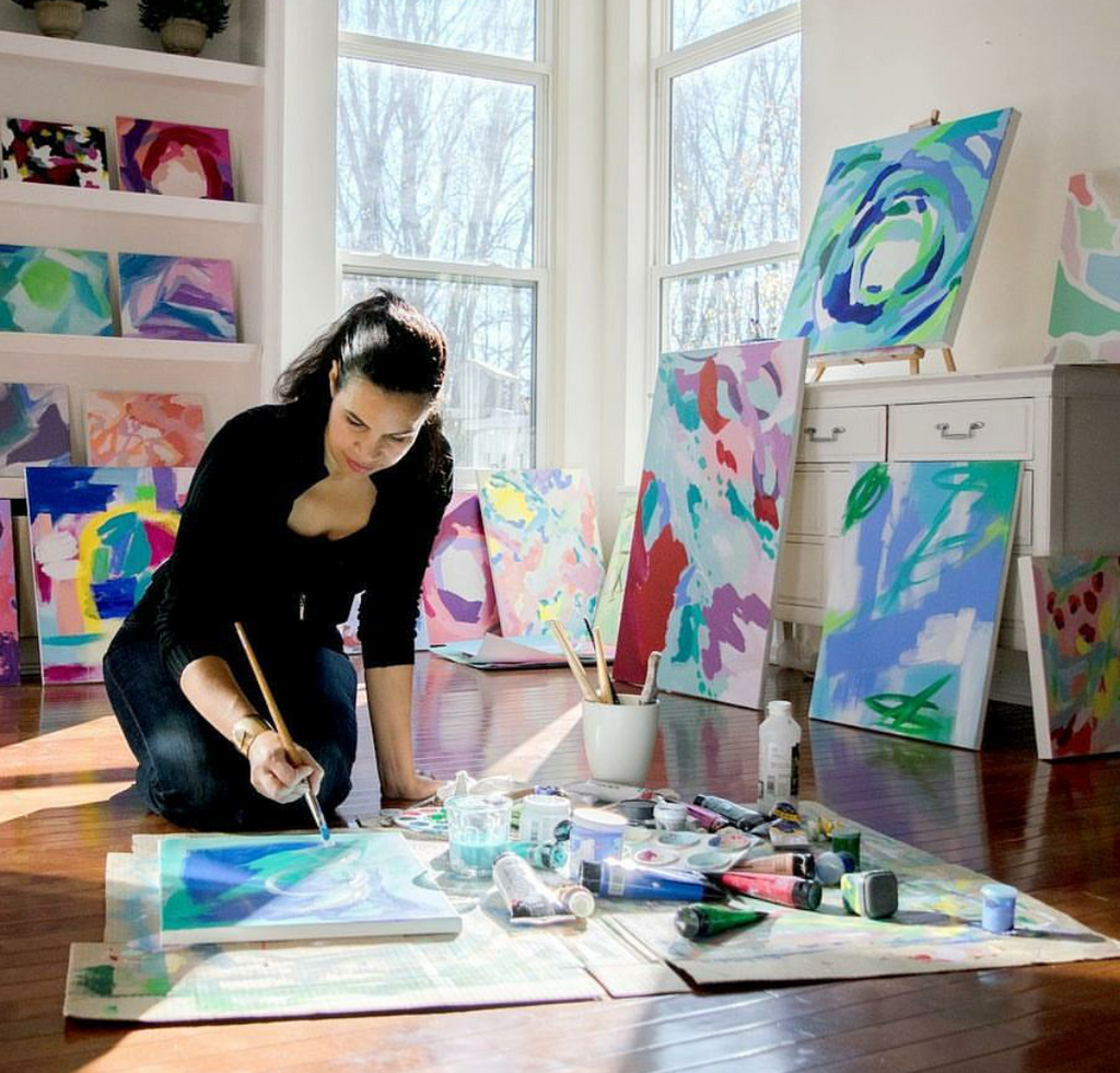 artist working painting with bright colors