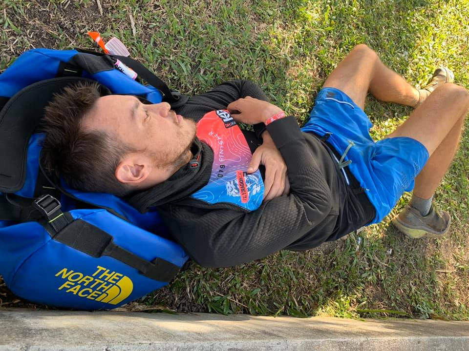 John Ellis sleeping at the finish line of Ultra Trail Panoramic in 2019