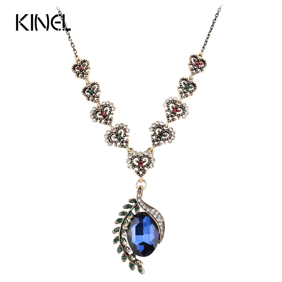 Kinel Asymmetrical Antique Gold Plated Blue Glass and Crystal Pendant Necklace For Women Leaves Hearts