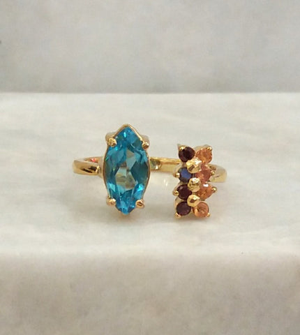 Blue Topaz with Citrines and Garnets Bypass Ring