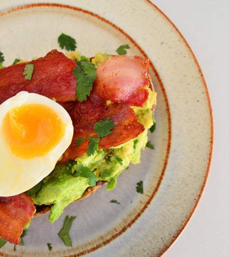 Avocado toast with bacon & eggs