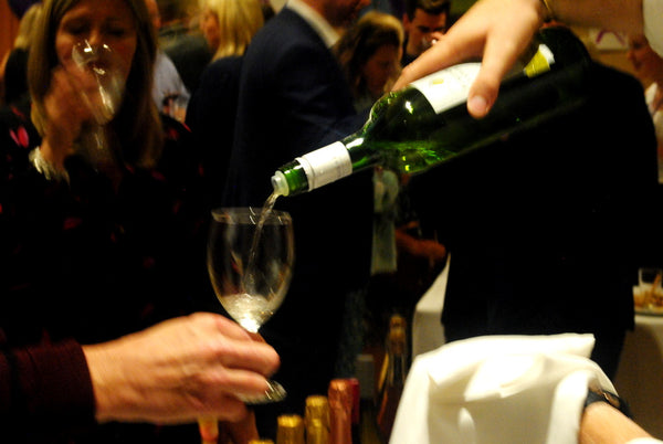 Pouring white wine at the Novel Wines launch party
