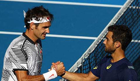 Roger Federer and Noah Rubin