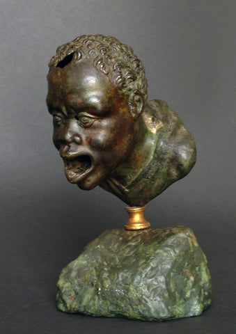 A Roman Bronze Oil Lamp Head of a Nubian