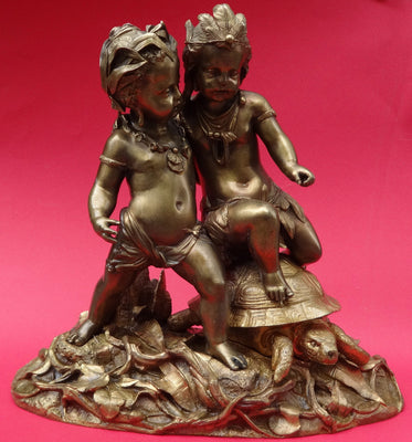 AFRICA AND AMERICA STATUETTE CHERUBS AND A TURTLE